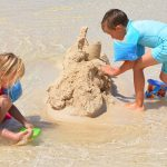 Building a sand castle is one example of play based learning