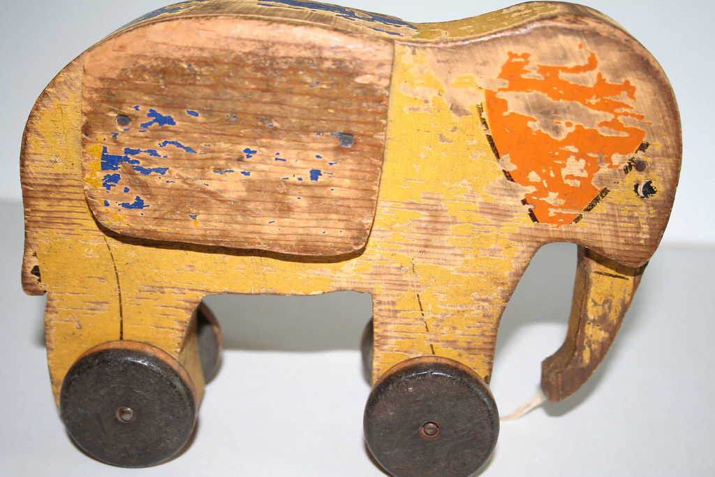 A wooden toy with chipped paint